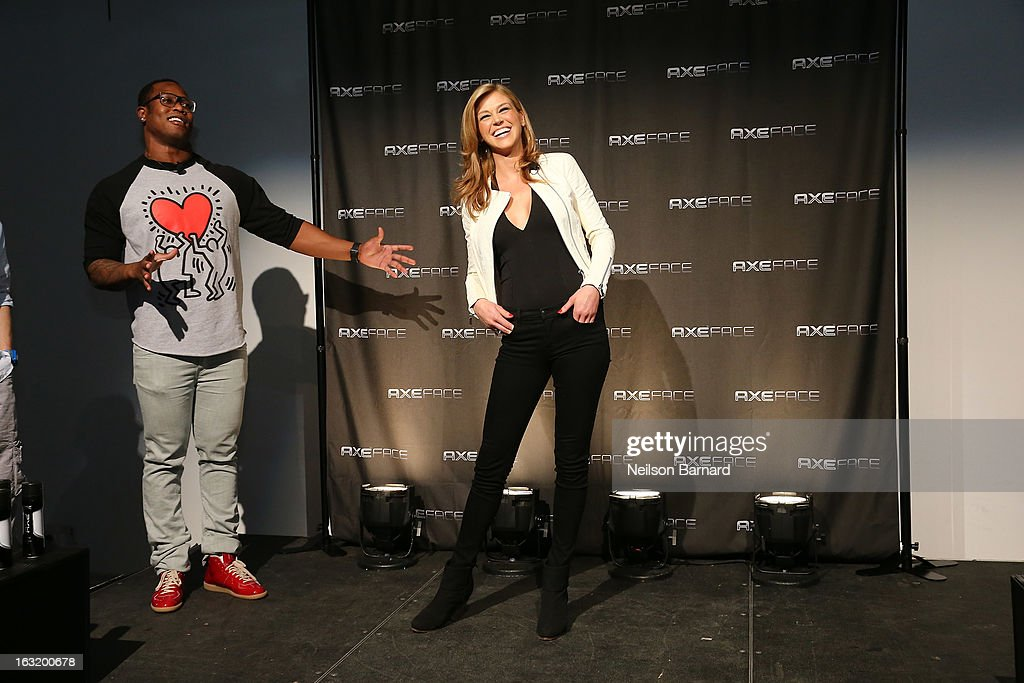 Denver linebacker Von Miller (L) introduces action film star Adrianne Palicki at the AXE Facescore event at Drive-In Studio on March 5, 2013 in New York City.