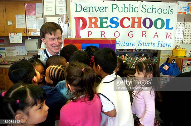 Denver mayor John Hickenlooper gets a big group hug from a bunch of four year olds in the Colorado Preschool Project at Columbine Elementary School...