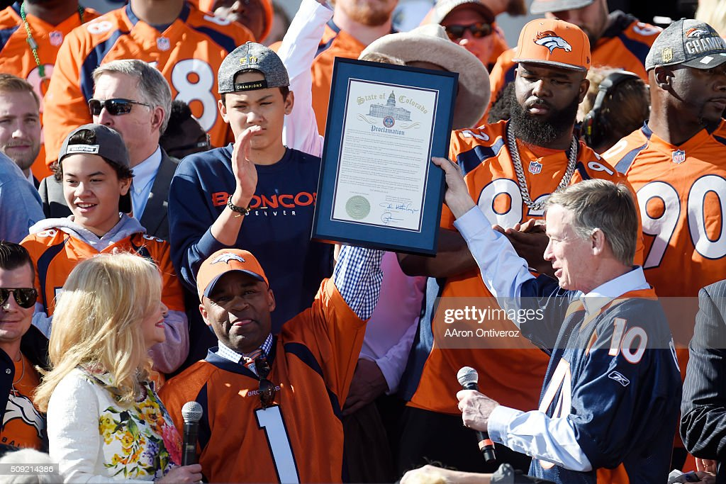 Denver Mayor Michael B. Hancock (bottom center) and governor John Hickenlooper (bottom right) hold a joint proclamation making the day Pat Bowlen day as his wife, Annabel Bowlen, looks on during the Denver Broncos Super Bowl championship celebration and parade on Tuesday February 9, 2016.