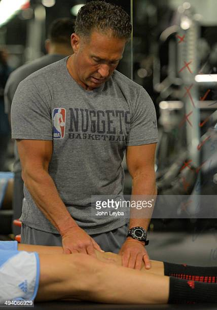 Denver Nuggets assistant coach/strength and conditioning Steve Hess works on Danilo Gallinari before his workout in the training room Denver Nuggets...