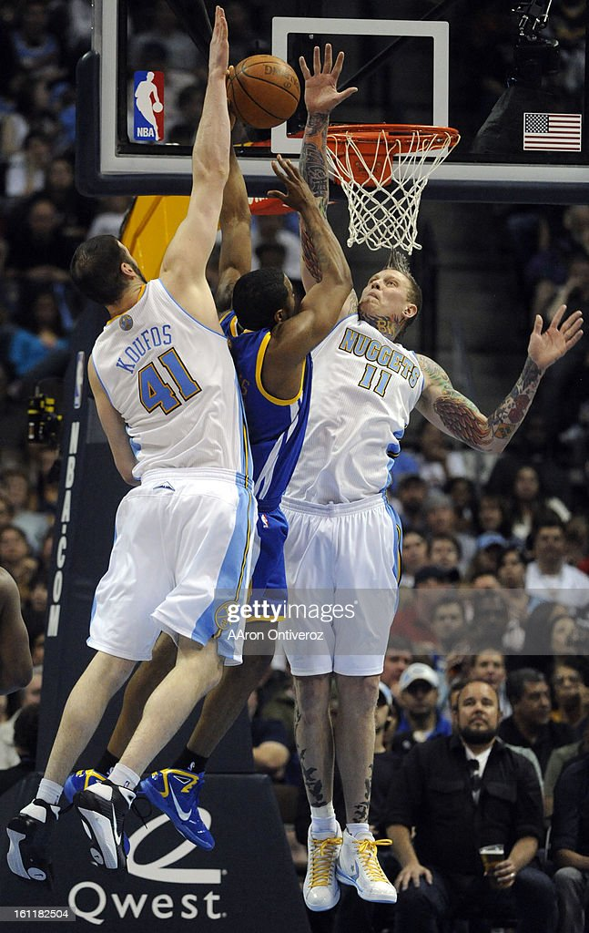 Denver Nuggets center Chris Andersen and center Kosta Koufos block a shot attempt by Golden State Warriors small forward Reggie Williams during the...