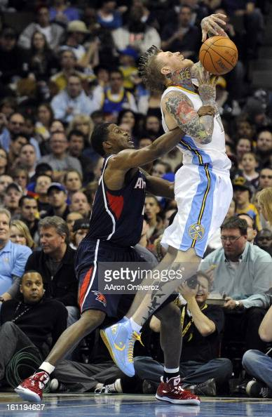Denver Nuggets center Chris Andersen draws contact from Atlanta Hawks shooting guard Joe Johnson during the second half of the Nuggets' 10090 win on...