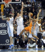 Denver Nuggets center Chris Andersen forward Danilo Gallinari and point guard Andre Miller attempt to block a shot by Phoenix Suns point guard...