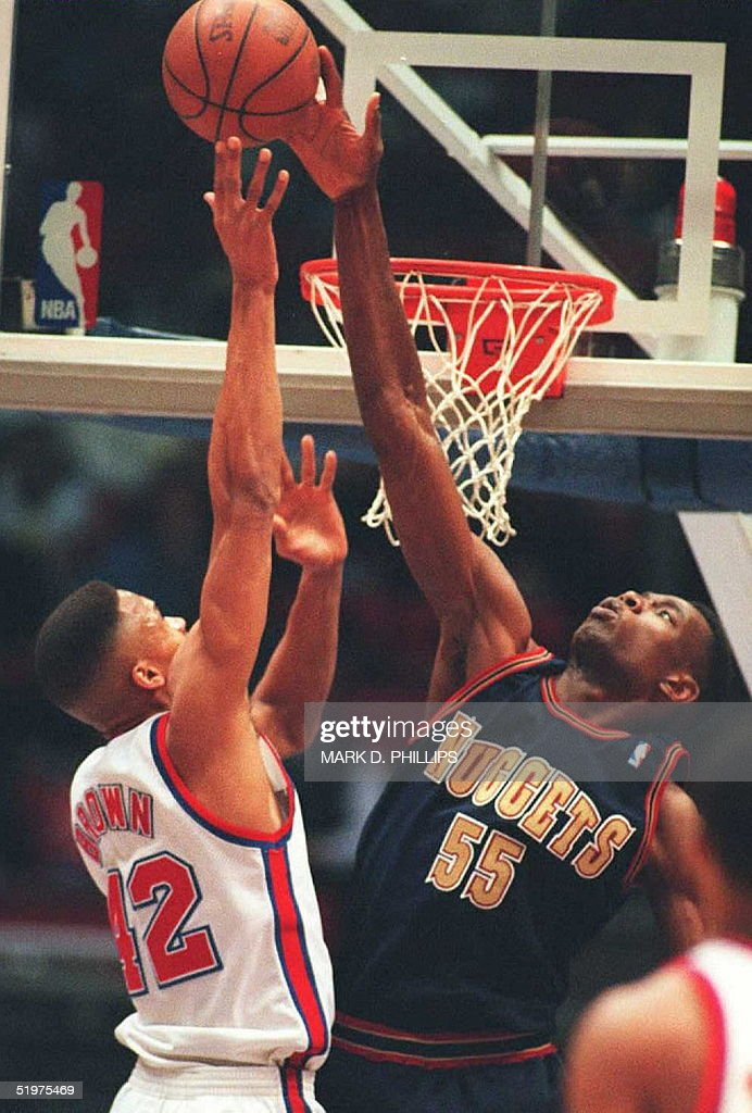 ... Denver Nuggets center Dikembe Mutombo blocks a layup by New Jersey Nets  P.J. Brown ... 658a2f4fe