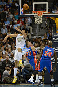 Denver Nuggets center JaVale McGee left goes after a ball under the basket against Detroit Pistons forward Jonas Jerebko and Detroit Pistons center...