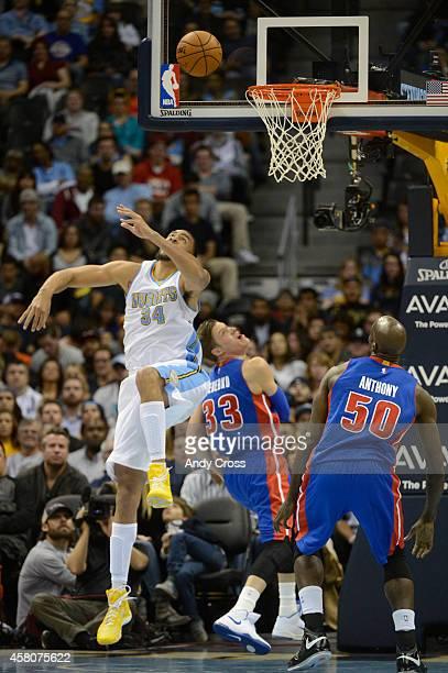 Denver Nuggets center JaVale McGee left goes after a ball under the basket against Detroit Pistons forward Jonas Jerebko and Detroit Pistons center...