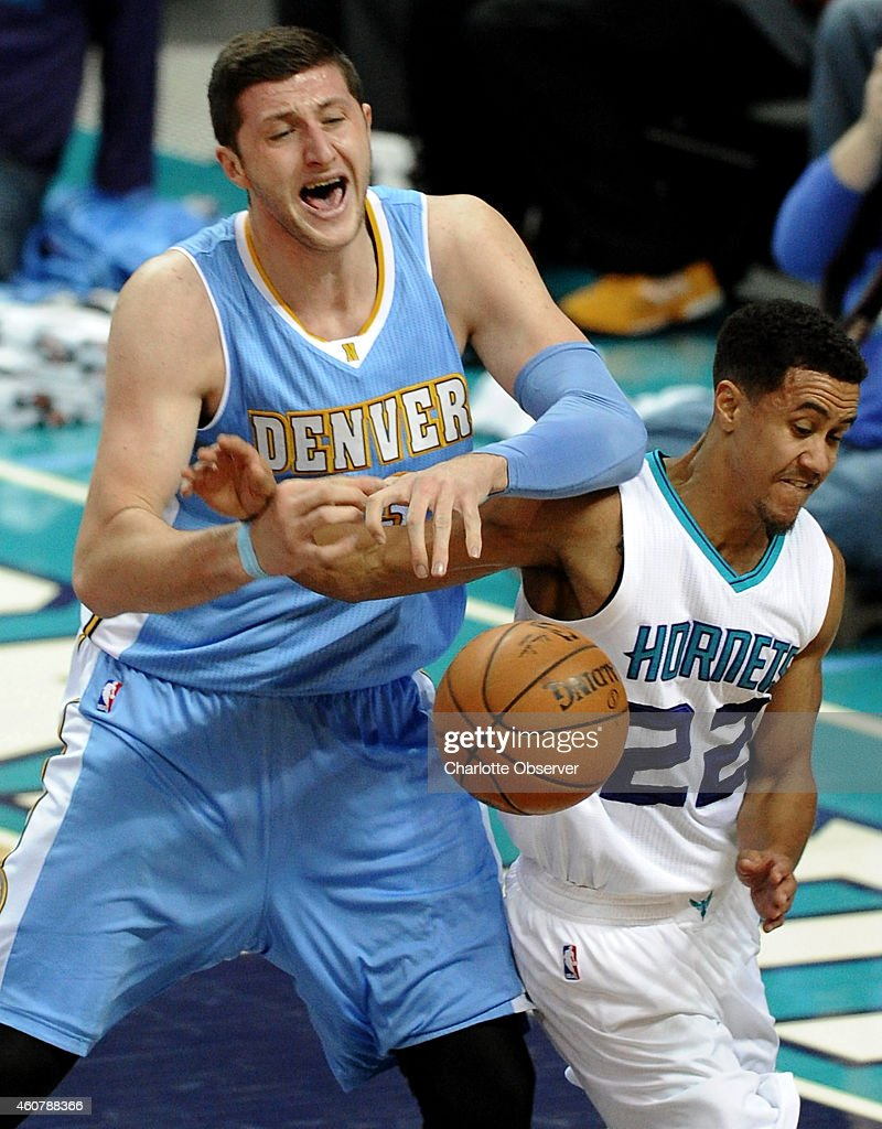 Denver Nuggets center Jusuf Nurkic and Charlotte Hornets guard Brian Roberts fight for control of the ball during first half action on Monday Dec 22...