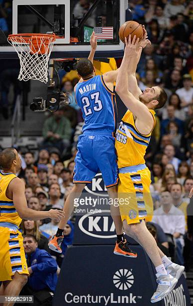 Denver Nuggets center Kosta Koufos pulls down a rebound from Oklahoma City Thunder shooting guard Kevin Martin during the first quarter January 20...