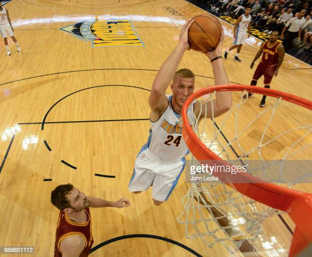 Denver Nuggets center Mason Plumlee goes up for a dunk on Cleveland Cavaliers forward Kevin Love during the first quarter on March 22 2017 in Denver...