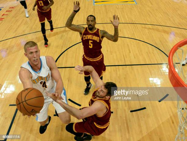 Denver Nuggets center Mason Plumlee goes up for a shot on Cleveland Cavaliers forward Kevin Love during the first quarter on March 22 2017 in Denver...
