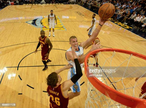 Denver Nuggets center Mason Plumlee goes up for a shot on Cleveland Cavaliers guard Kyle Korver during the first quarter on March 22 2017 in Denver...
