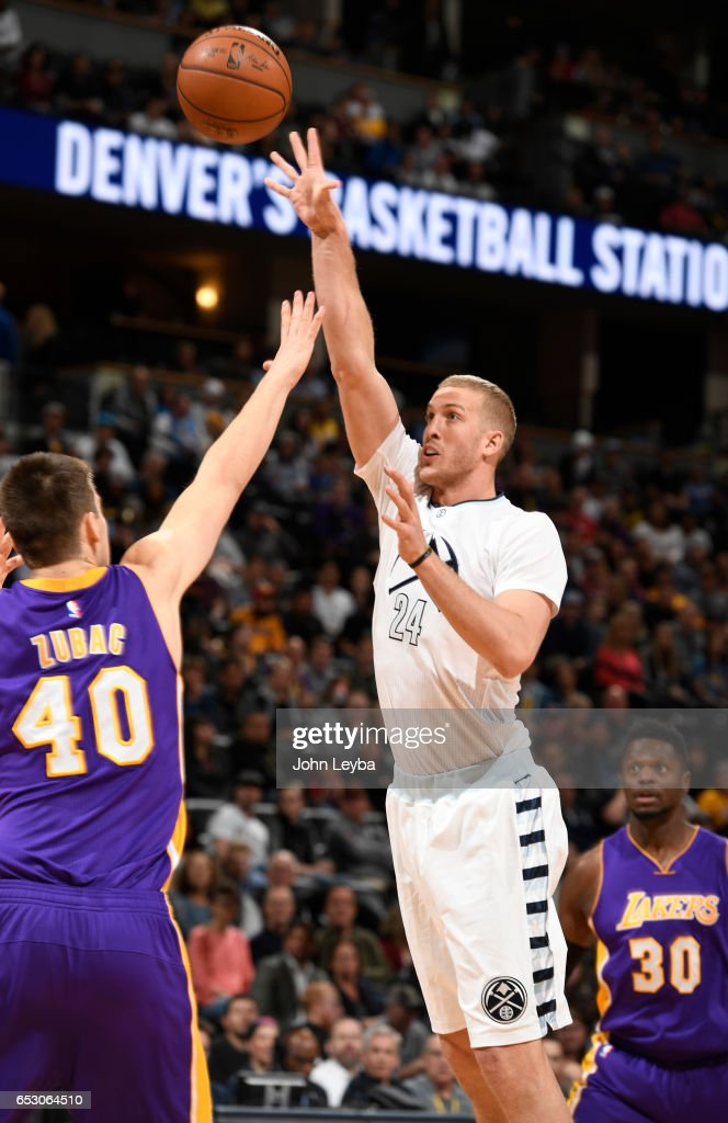 Denver Nuggets center Mason Plumlee (24) goes up for a shot on Los Angeles Lakers center Ivica Zubac (40) during the first quarter on March 13, 2017 in Denver, Colorado at Pepsi Center.