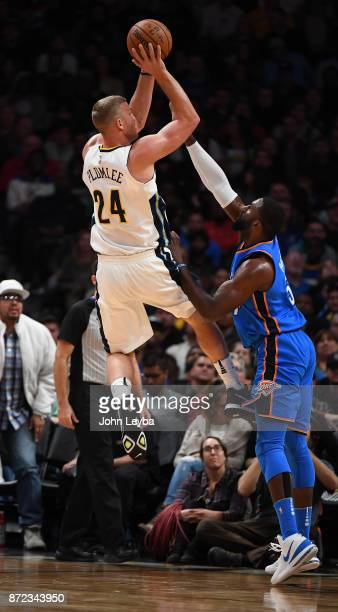 Denver Nuggets center Mason Plumlee takes a shot over Oklahoma City Thunder forward Patrick Patterson during the fourth quarter on November 9 2017 in...
