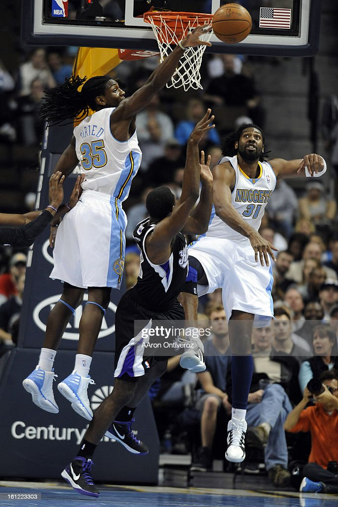 Denver Nuggets center Nene (31) and forward Kenneth Faried (35) defend Sacramento Kings point guard Tyreke Evans (13) during the second half of the Nuggets' 119-116 win at the Pepsi Center on Monday, March 5, 2011. AAron Ontiveroz, The Denver Post