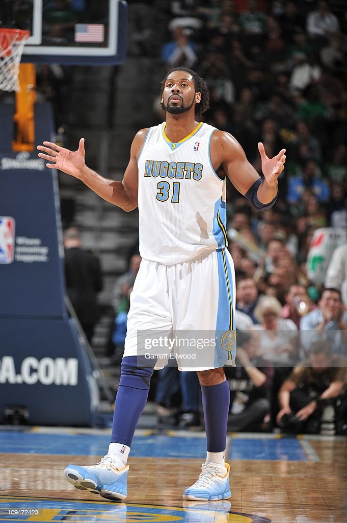 Denver Nuggets center <a gi-track='captionPersonalityLinkClicked' href=/galleries/search?phrase=Nene+Hilario+-+Basketball&family=editorial&specificpeople=4250456 ng-click='$event.stopPropagation()'>Nene Hilario</a> #31 reacts during the game against the Boston Celtics on February 24, 2011 at the Pepsi Center in Denver, Colorado. The Nuggets won 89-75.