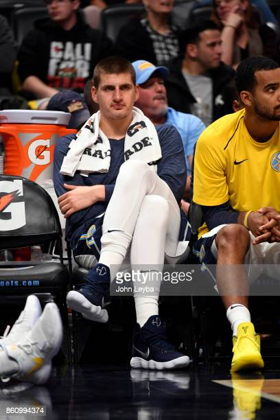 Denver Nuggets center Nikola Jokic sits on the bench in the fourth quarter against the Oklahoma City Thunder on October 10 2017 in Denver Colorado at...