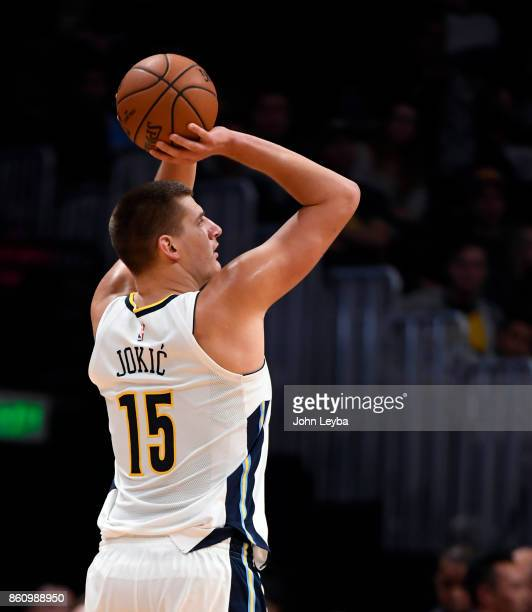 Denver Nuggets center Nikola Jokic takes a shot during the game against the Oklahoma City Thunder on October 10 2017 in Denver Colorado at Pepsi...