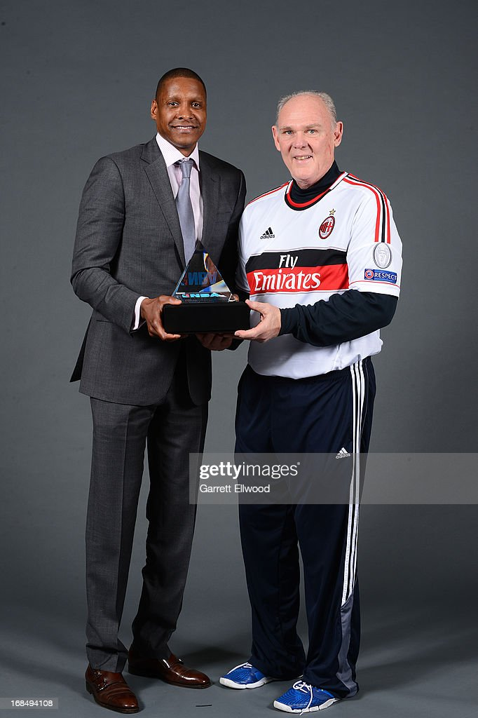 Denver Nuggets Executive Vice President of Basketball Operations Masai Ujiri poses for a photo with Head Coach George Karl after being named 2012-2013 NBA Executive of the Year on May 9, 2013 at the Pepsi Center in Denver, Colorado.