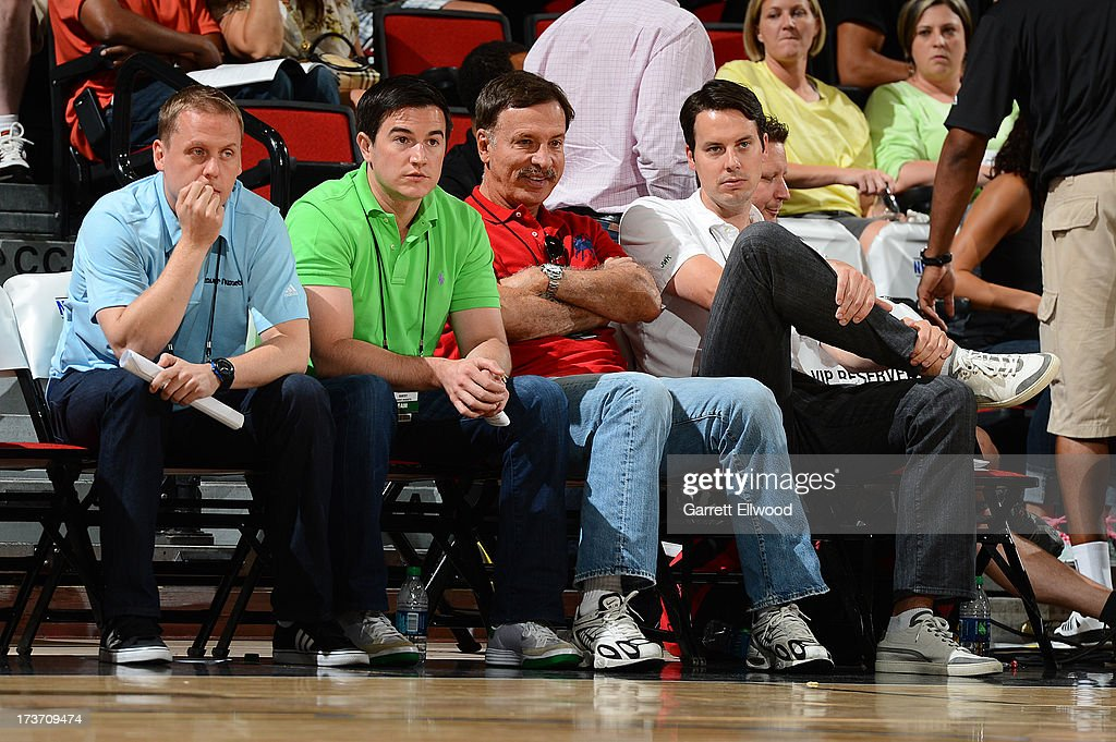 Denver Nuggets executives (L-R) General Manager Tim Connelly, Assistant General Manager Arturas Karnisovas, owner <a gi-track='captionPersonalityLinkClicked' href=/galleries/search?phrase=E.+Stanley+Kroenke&family=editorial&specificpeople=2433539 ng-click='$event.stopPropagation()'>E. Stanley Kroenke</a> and owner and President <a gi-track='captionPersonalityLinkClicked' href=/galleries/search?phrase=Josh+Kroenke&family=editorial&specificpeople=3079825 ng-click='$event.stopPropagation()'>Josh Kroenke</a> attend the NBA Summer League game between the Denver Nuggets and the Washington Wizards on July 16, 2013 at the Cox Pavilion in Las Vegas, Nevada.