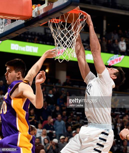 Denver Nuggets forward Danilo Gallinari gets a dunk on Los Angeles Lakers center Ivica Zubac during the first quarter on March 13 2017 in Denver...
