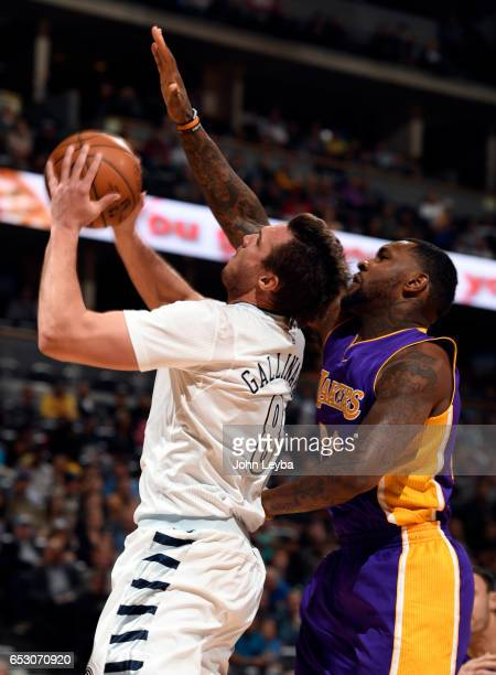Denver Nuggets forward Danilo Gallinari gets fouled by Los Angeles Lakers center Tarik Black during the first quarter as he goes up for a shot on...