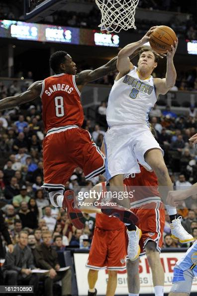 Denver Nuggets forward Danilo Gallinari is fouled by Milwaukee Bucks power forward Larry Sanders during the second quarter at the Pepsi Center on...