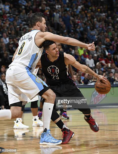Denver Nuggets forward Danilo Gallinari swipes a the ball and hits Los Angeles Clippers guard Austin Rivers on the head as he drive through the lane...
