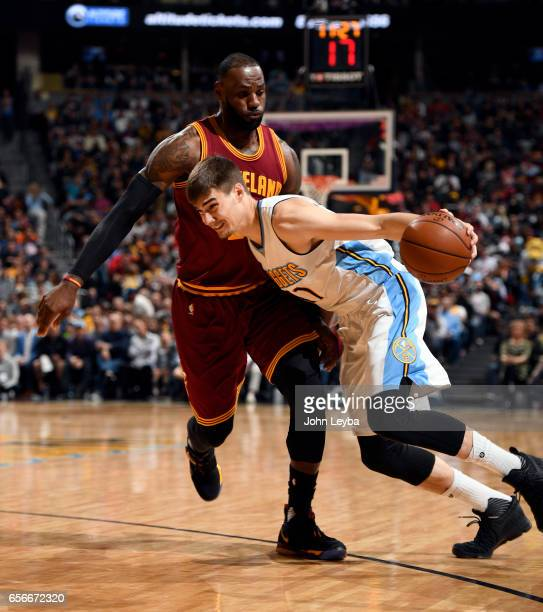 Denver Nuggets forward Juan Hernangomez drives on Cleveland Cavaliers forward LeBron James during the second quarter on March 22 2017 in Denver...