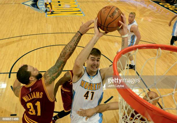 Denver Nuggets forward Juan Hernangomez goes up for a basket past Cleveland Cavaliers guard Deron Williams during the first quarter on March 22 2017...