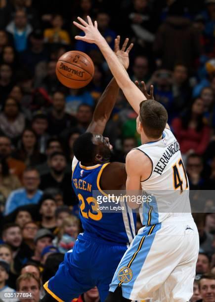 Denver Nuggets forward Juancho Hernangomez an dGolden State Warriors forward Draymond Green battle for a rebound during the first quarter February 13...