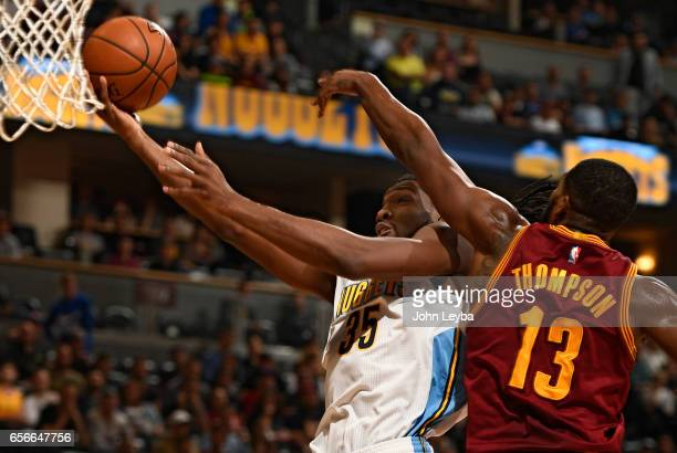 Denver Nuggets forward Kenneth Faried drives to the basket on Cleveland Cavaliers center Tristan Thompson during the first quarter on March 22 2017...