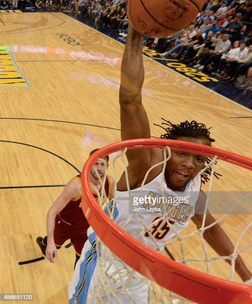 Denver Nuggets forward Kenneth Faried gets a dunk during the first quarter against the Cleveland Cavaliers on March 22 2017 in Denver Colorado at...