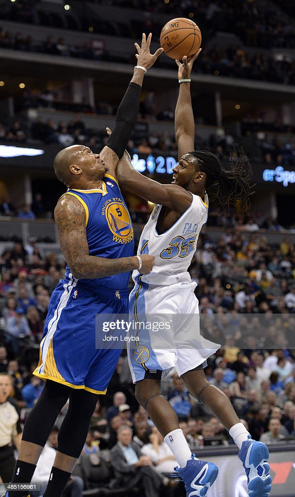 Denver Nuggets forward Kenneth Faried (35) gets his jersey pulled by Golden State Warriors forward Marreese Speights (5) as he goes up for a shot during the first quarter April 16, 2014 at Pepsi Center.