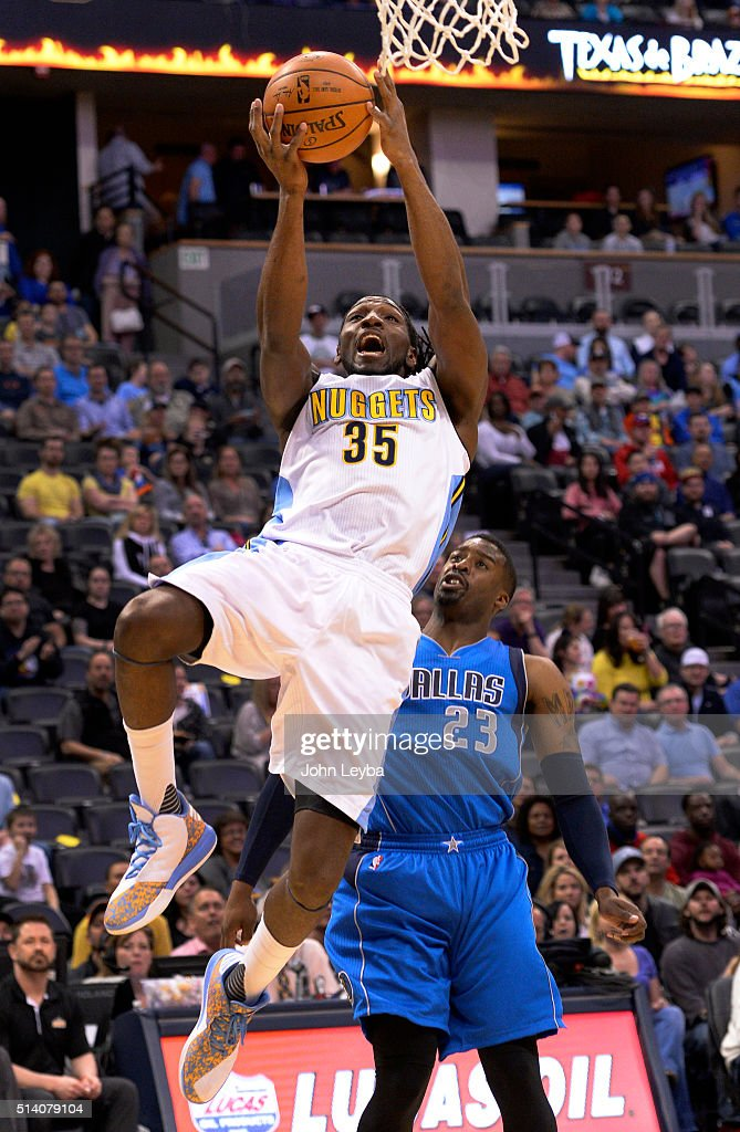 Denver Nuggets forward <a gi-track='captionPersonalityLinkClicked' href=/galleries/search?phrase=Kenneth+Faried&family=editorial&specificpeople=5765135 ng-click='$event.stopPropagation()'>Kenneth Faried</a> (35) goes up for a basket past Dallas Mavericks guard <a gi-track='captionPersonalityLinkClicked' href=/galleries/search?phrase=Wesley+Matthews+-+Basketball+Player&family=editorial&specificpeople=804816 ng-click='$event.stopPropagation()'>Wesley Matthews</a> (23) during the first quarter March 6, 2016 at Pepsi Center. Fried missed the layup on the attempt.
