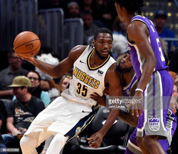 Denver Nuggets forward Kenneth Faried leans on Sacramento Kings forward JaKarr Sampson during the fourth quarter on October 21 2017 at Pepsi Center