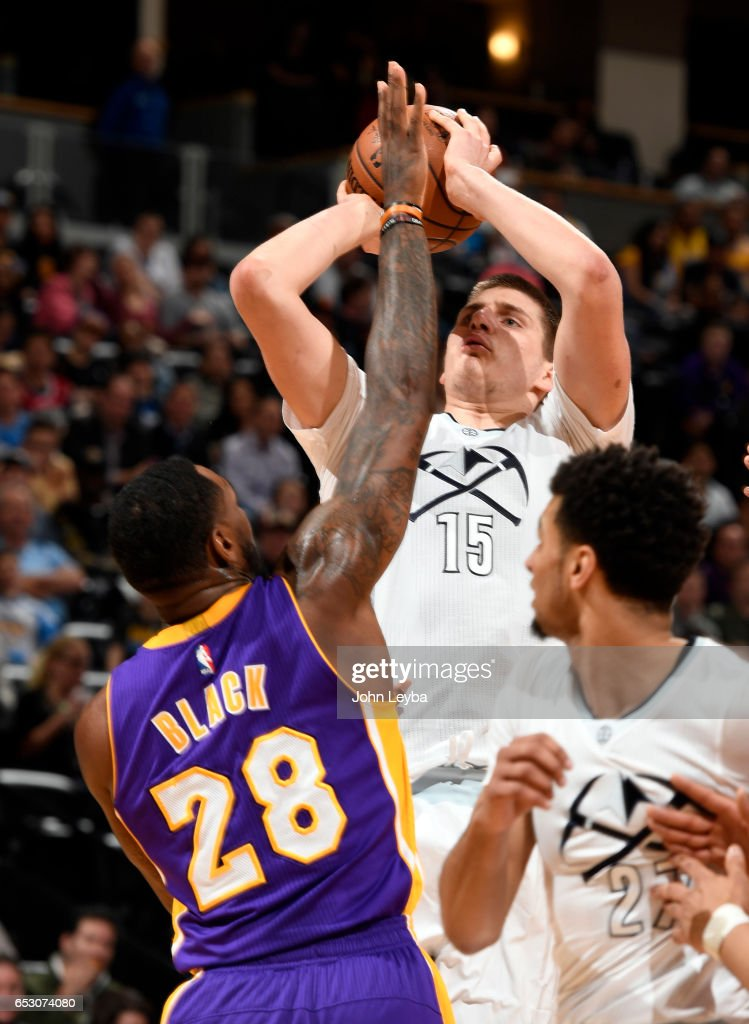Denver Nuggets forward Nikola Jokic (15) takes a shot over Los Angeles Lakers center Tarik Black (28) during the second quarter on March 13, 2017 in Denver, Colorado at Pepsi Center.