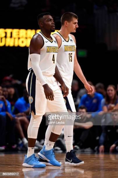 Denver Nuggets forward Paul Millsap and center Nikola Jokic during a break in the action against the Oklahoma City Thunder on October 10 2017 in...