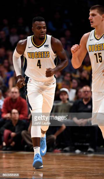 Denver Nuggets forward Paul Millsap and center Nikola Jokic head down court during the game against the Oklahoma City Thunder on October 10 2017 in...