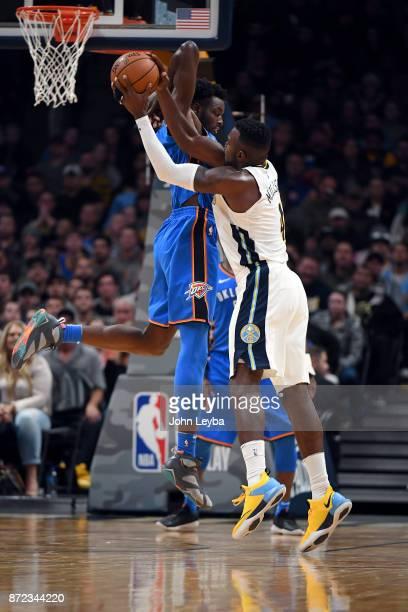 Denver Nuggets forward Paul Millsap draws the foul on Oklahoma City Thunder forward Jerami Grant during the fourth quarter on November 9 2017 in...