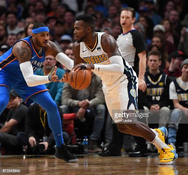 Denver Nuggets forward Paul Millsap drives on Oklahoma City Thunder forward Carmelo Anthony during the fourth quarter on November 9 2017 in Denver...