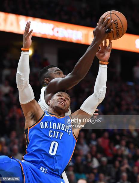 Denver Nuggets forward Paul Millsap hauls down a rebound away from Oklahoma City Thunder guard Russell Westbrook during the fourth quarter on...