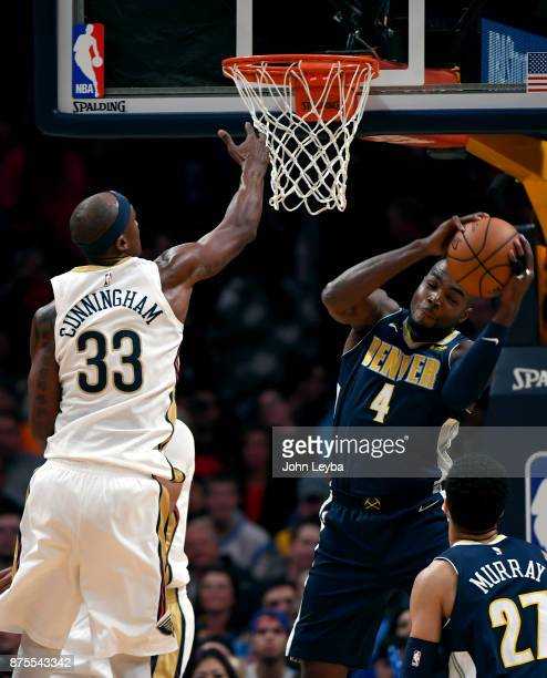 Denver Nuggets forward Paul Millsap hauls down a rebound away from New Orleans Pelicans forward Dante Cunningham during the first quarter on November...