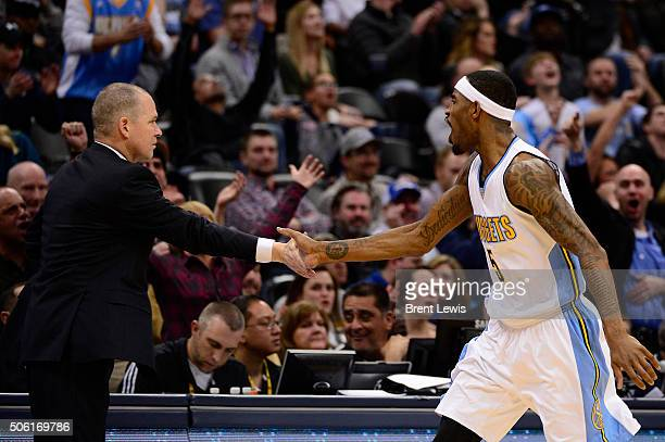 Denver Nuggets forward Will Barton high fives Denver Nuggets head coach Michael Malone after making the three pointer to tie the game during the...