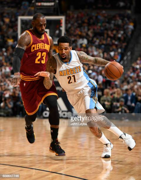 Denver Nuggets forward Wilson Chandler drives on Cleveland Cavaliers forward LeBron James during the first quarter on March 22 2017 in Denver...