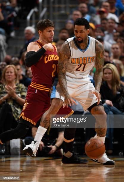 Denver Nuggets forward Wilson Chandler gets guarded by Cleveland Cavaliers guard Kyle Korver during the fourth quarter on March 22 2017 in Denver...
