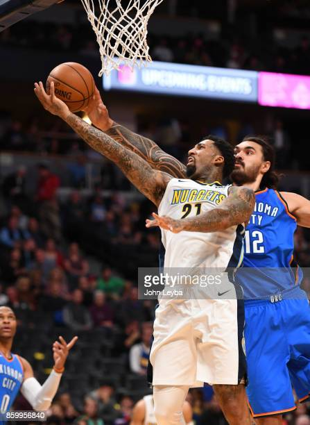 Denver Nuggets forward Wilson Chandler gets his shot blocked by Oklahoma City Thunder center Steven Adams during the first quarter on October 10 2017...