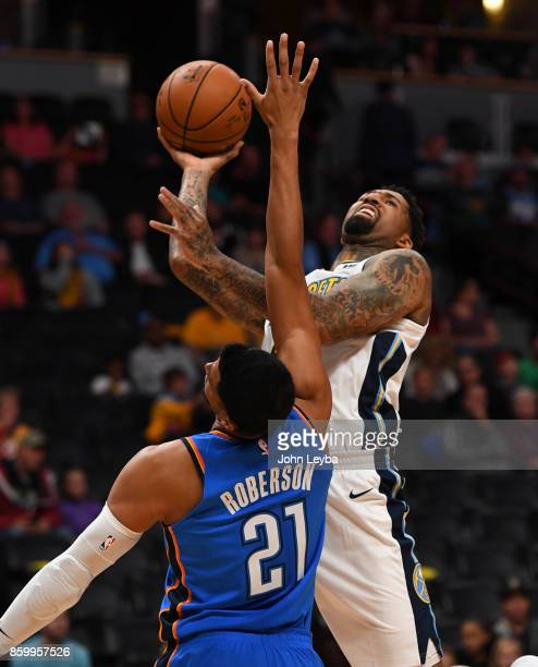 Denver Nuggets forward Wilson Chandler goes up for a shot on Oklahoma City Thunder guard Andre Roberson during the first quarter on October 10 2017...