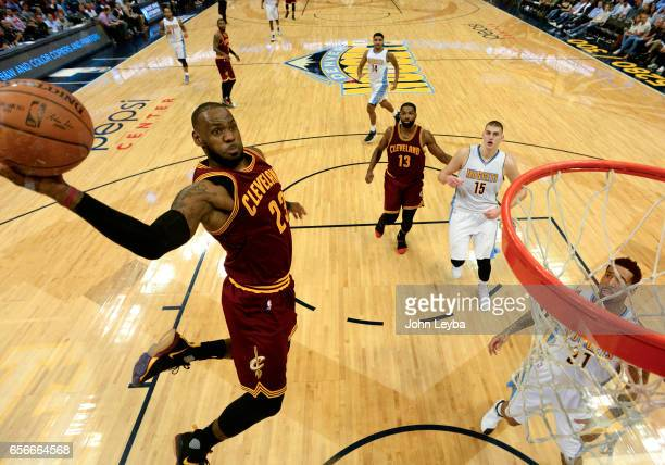 Denver Nuggets forward Wilson Chandler looks on as Cleveland Cavaliers forward LeBron James goes up for a big dunk during the third quarter on March...