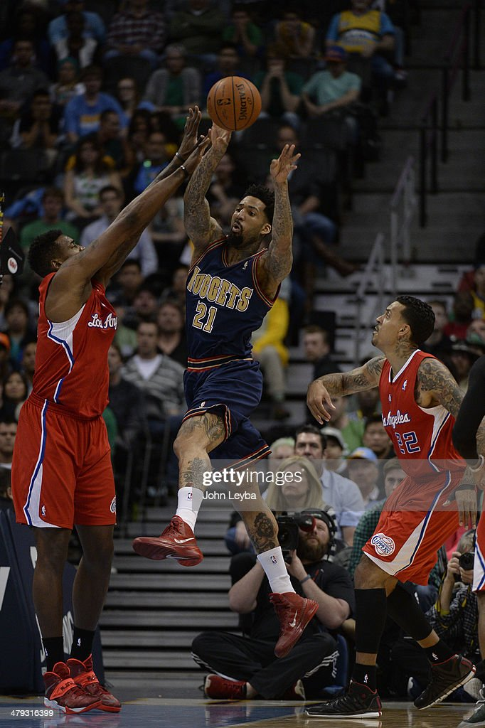 Denver Nuggets forward Wilson Chandler makes a pass as Los Angeles Clippers center DeAndre Jordan defends on the play late in then fourth quarter...