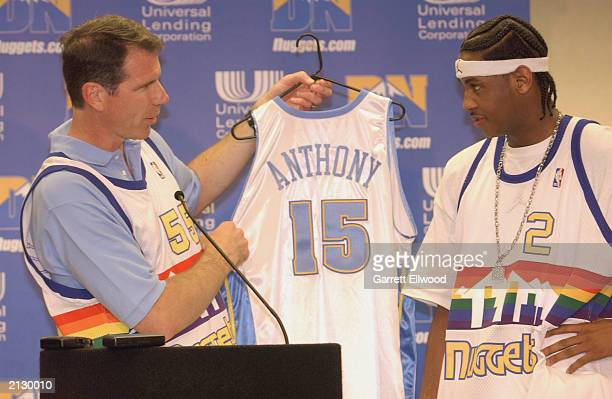 Denver Nuggets General Manager Kiki Vandeweghe presents a jersey to draft pick Carmelo Anthony during a press conference at the Pepsi Center on June...